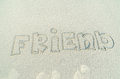Inscription on sand friends text Stock Image