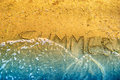 The inscription on sand summer is washed off by a wave Stock Photos