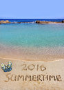 Inscription summertime and the sea on wet sand of beach in a quiet cove of mediterranean beach slippers Royalty Free Stock Photography