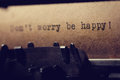 Inscription on a typewriter the don t worry be happy printed Stock Images