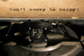 Inscription on a typewriter label don t worry be happy Royalty Free Stock Photos