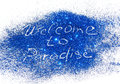Inscription Welcome to Paradise of blue glitter sparkle on white background