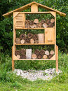 Insect and bug hotel wooden house designed to provide shelter for insects other creatures Stock Photography