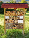 Insect hotel in garden Royalty Free Stock Photo