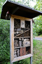 Insect hotel with several compartments structure created natural materials as refuge for different kind of insects Stock Photo