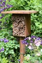 Insect hotel for wild bees and other insects. made of wood and b