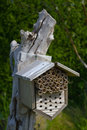 Insect house for bees and other insects mad in wood an mounted on an old tree stump Stock Photo