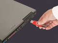 Inserting memory stick woman s hand insert usb Royalty Free Stock Photo