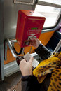 Inserting the ticket a woman in train tram to milan Royalty Free Stock Photo