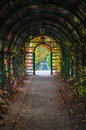 Inside arch with autumnal time lianes and lanterns Royalty Free Stock Photo