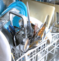 Inside of as dishwasher containing dirty dishes Stock Photos