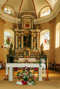 Inside of a church with altar and flower Royalty Free Stock Photo