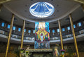 Inside of a church with paintings jesus with skylight showing blue sky Royalty Free Stock Images