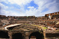 Inside the colloseum rome view of ancient roman amphitheatre interior with clouds and blue sky Royalty Free Stock Photography
