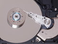 Inside harddisk open computer platters and reader Royalty Free Stock Images