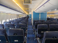 Inside a jumbo jet the passenger cabin of airliner Stock Photography