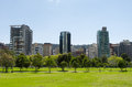 Inside la carolina park in quito ecuador march beautiful green outdoors with some tall office buildings marking the Royalty Free Stock Photos