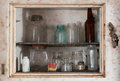 Inside the old fridge bottles and glass jars rusty refridgerator Royalty Free Stock Photos