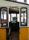 The inside of an old historic yellow tram with graffiti in Lisbon Royalty Free Stock Photo