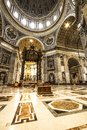 INSIDE SAINT PETER BASILICA WIT BALDACHIN ALTAR.  FAMOUS DESTINATION OF ROME. Royalty Free Stock Photo