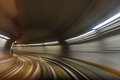 Inside tunel blur abstract scene traveling by train looking forward Royalty Free Stock Photo