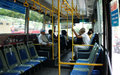 Inside vietnam bus ho chi minh city july public transport vehicles at city passenger sit on bench yellow handhold people Stock Photography