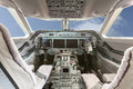 Inside view Cockpit G550 with blue sky and clouds Royalty Free Stock Photo