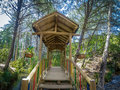 Inside view of small colorful covered wooden bridge - Parque Arvi, Medellin, Colombia Royalty Free Stock Photo