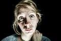 Insomniac sad and hopelessness woman needing help isolated on black Stock Photo
