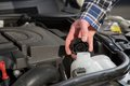 Inspect a car engine water canister service mechanic opened the cap from to the level for the Royalty Free Stock Photos