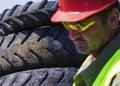 Inspect junkyard. Focus on tires. Royalty Free Stock Photo