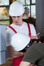 Inspector controlling worker at factory vertical view of Stock Photography