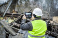 Inspector with tablet pc near collapsed building Royalty Free Stock Images