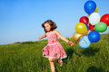 Inspiration happy little girl jumping outdoors with balloons Royalty Free Stock Images