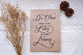 Inspirational motivating quote on notebook with handwritten typ