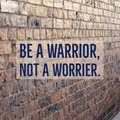 Inspirational motivational quote `Be a warrior, not a worrier.`