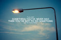 Inspirational and motivational quote poster by unknown source on vintage street lamp background Stock Photography
