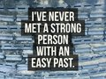 Inspirational quote `I have never met a strong person with an easy past.` Royalty Free Stock Photo