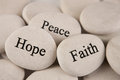 Inspirational stones close up of with engraved words hope faith peace Stock Photos