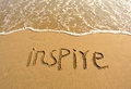 Inspire drawn on the beach word and sea water Royalty Free Stock Photos