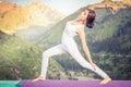 Inspired asian woman doing exercise of yoga at mountain range Royalty Free Stock Photo