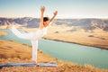 Inspired asian woman doing exercise of yoga at mountain range kazakhstan she dressed in white sportswear Stock Images