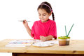 Inspired little girl who draws Royalty Free Stock Photos