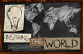 Inspiring the world on blackboard walllpaper Stock Images