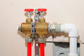 Installation individual of home heating. Connecting pipe warm water floor to the manifold heating. Royalty Free Stock Photo