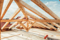Installation of wooden beams at house construction site. Building details with wood, timber and iron holders Royalty Free Stock Photo