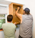 Installing Cabinets - Teamwork Royalty Free Stock Photo