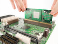 Installing processor on motherboard pcb Stock Photography