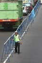 Installing roadblock police officer to separating the two opposing lines in solo centrl java indonesia Stock Images