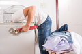 Installing washing machine handyman with big spanner Royalty Free Stock Image